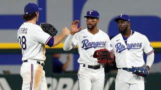 DJ Peters #38, Leody Taveras #3, and Adolis Garcia #53 of the Texas Rangers celebrate the win over the Chicago White Sox at Globe Life Field on Sept. 18, 2021 in Arlington, Texas.