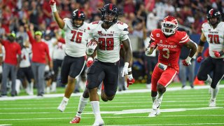Texas Tech Red Raiders running back Tahj Brooks (28) breaks loose on a long rushing touchdown during first half action during the football game between the Texas Tech Red Raiders and University of Houston Cougars at NRG Stadium on Sept. 4, 2021 in Houston, Texas.