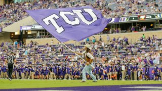 A TCU Horned Frogs flag runner waves a TCU flag during the game between the TCU Horned Frogs and the Duquesne Dukes on Sept. 4, 2021 at Amon G. Carter Stadium in Fort Worth, Texas.