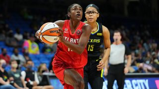 Tiffany Hayes #15 of the Atlanta Dream drives to the basket during the game against the Dallas Wings on Sept. 5, 2021 at College Park Center in Arlington, Texas.