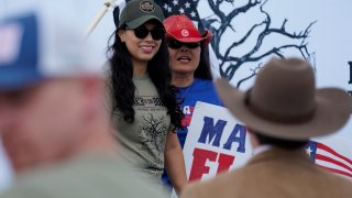 In this Saturday, Sept. 25, 2021, photo Republican congressional candidate Mayra Flores, left, attends a March to the Border event in McAllen, Texas
