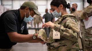 Sgt. Katiushka Rivera gets fitted for a modular scalable vest