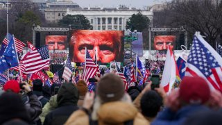 FILE - In this Jan. 6, 2021, file photo, the face of President Donald Trump appears on large screens as supporters participate in a rally in Washington. The House committee investigating the violent Jan. 6 Capitol insurrection, with its latest round of subpoenas in September 2021, may uncover the degree to which former President Donald Trump, his campaign and White House were involved in planning the rally that preceded the riot, which had been billed as a grassroots demonstration.