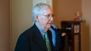 Senate Minority Leader Mitch McConnell of Ky., walks back to his office on Capitol Hill, Thursday, Oct. 7, 2021, in Washington.