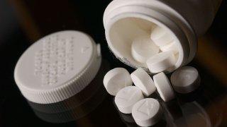 Aspirin tablets spilled from a bottle. 25 April 2002