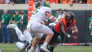 Oklahoma State Cowboys running back Jaylen Warren (7) dives for the end zone for a touchdown against the Baylor Bears on Oct. 2, 2021 at Boone Pickens Stadium in Stillwater, Oklahoma.