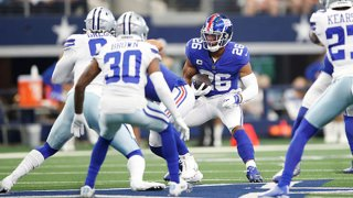 Saquon Barkley #26 of the New York Giants runs the ball during the first quarter against the Dallas Cowboys at AT&T Stadium on Oct. 10, 2021 in Arlington, Texas.