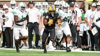 Missouri Tigers running back Tyler Badie (1) breaks free for a big run during a game between the North Texas Mean Green and the Missouri Tigers on Oct. 9, 2021, at Faurot Field at Memorial Stadium in Columbia, Missouri.