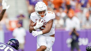 Texas Longhorns running back Bijan Robinson (5) runs through the line of scrimmage during the game between the TCU Horned Frogs and the Texas Longhorns on Oct. 2, 2021 at Amon G. Carter Stadium in Fort Worth, Texas.