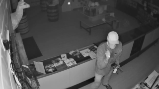 Law enforcement officials are looking for a man suspected of stealing 21 firearms from a business in Denton County that happened in September.