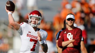 Spencer Rattler #7 of the Oklahoma Sooners warms up before the game against the Texas Longhorns during the 2021 AT&T Red River Showdown at Cotton Bowl on Oct. 9, 2021 in Dallas, Texas.