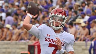 Quarterback Spencer Rattler #7 of the Oklahoma Sooners warms up before a game against the Kansas State Wildcats at Bill Snyder Family Football Stadium on Oct. 2, 2021 in Manhattan, Kansas.