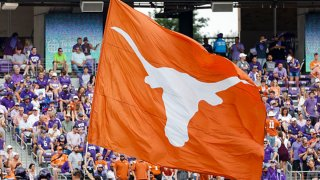 A Texas Longhorns flag runner flies the Texas flag after a touchdown during the game between the TCU Horned Frogs and the Texas Longhorns on Oct. 2, 2021 at Amon G. Carter Stadium in Fort Worth, Texas.