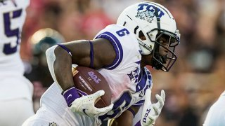 Running back Zach Evans #6 of the TCU Horned Frogs runs the ball during the first half of the college football game against the Texas Tech Red Raiders at Jones AT&T Stadium on Oct. 9, 2021 in Lubbock, Texas.