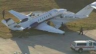 Small Jet Crashes Into Parked Plane During Emergency Landing