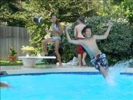 [UGCDFW-CJ-caption this]Surfing on water in backyard pool
