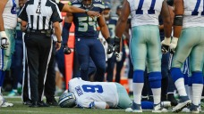 Cowboys' Romo Leaves After Getting Pulled Down Awkwardly