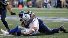 Romo Has Broken Bone in Back, Could Miss Several Weeks