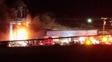 8 Fire Departments Battle Fire at Motorcycle Dealership