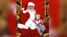 Toddler Signs for Help From Mall Santa's Lap