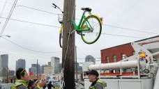 LimeBike Sawed in Half, Bolted to Deep Ellum Pole