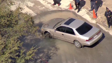 Car Crashes Into Sinkhole in Dallas