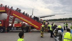 Passengers Safe After Jet Catches Fire in Singapore