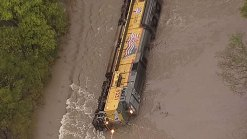 Train Partially Submerged After Hitting High Water