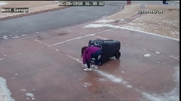 Girl Slips on Ice While Doing Chores