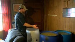 Man Arrested After Barrels of Moonshine Discovered in Home