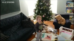 Toddler Busted After Unwrapping Gifts