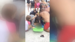 Boy Is Bitten By Shark, Pulled From Surf by Nearby Swimmer