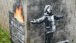 Banksy Mural on Garage in Wales Sold But Will Stay in Place