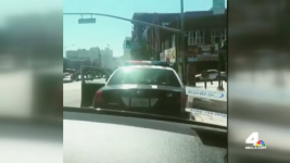 Rap Group's Gun-Behind-Cops Video Ends in Arrest: LAPD