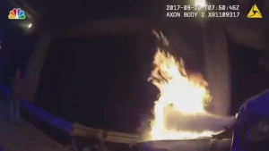 Dramatic Bodycam Footage Shows Police Rescue 2 From Burning Car