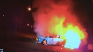 Officers Rescue Woman From Burning Car