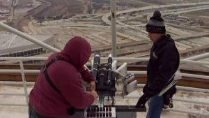 Crews Prepare Reunion Tower for New Year's Eve Fireworks Show