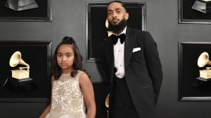Nipsey Hussle's Daughter Emani Pays Tribute to Late Dad at Elementary School Graduation