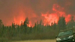Wildfire Rages in Canada; 25,000 Flee