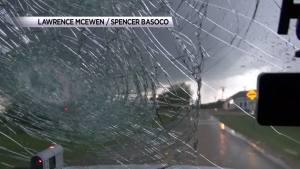 Hail Destroys Storm Chasers' Windshield
