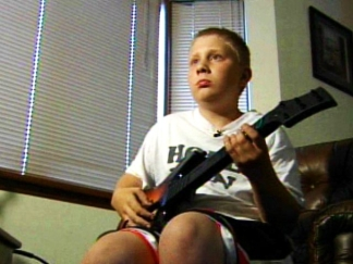 12-Year-Old Becomes Guitar Hero Champ