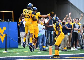 Grier, Crawford Lead West Virginia Over Delaware State 59-16
