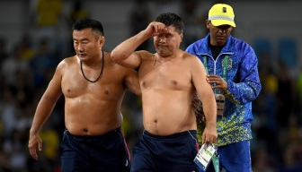 Wrestling Coaches Strip in Protest of Penalty Point