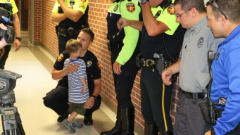 Amarillo Officers Escort Fallen Officers Kids to School