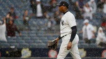 Chapman, Yankees Weather Heavy Rain, Hold Off Rangers