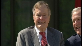 Elder Bush Honors Son at Dedication of Library