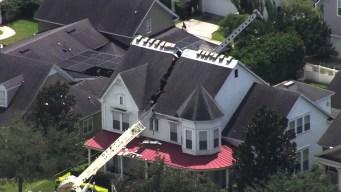 Crane Crashes Into Home, Splits House in Half