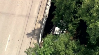 Raw Video: Dallas Police Car in Creek After Crash