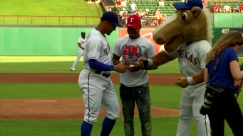 Errol Spence Jr. Throws First Pitch At Rangers Game