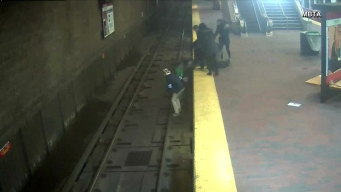 Students Save Man from Train Tracks